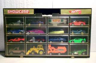 SHOWCASE 12 CAR DISPLAY CASE W / 12 CARS 80S/90S CARS NEAR MINT NR