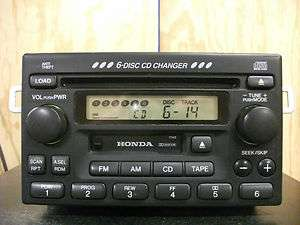Honda factory AM/FM 6 disc CD cassette player radio with code stereo