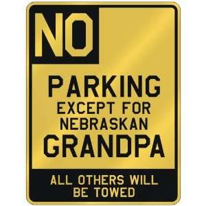 NO  PARKING EXCEPT FOR NEBRASKAN GRANDPA  PARKING SIGN